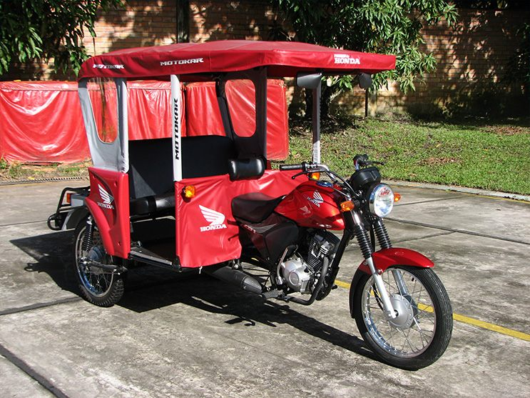 The three-wheeled 'Motokar' is an original product of the Iquitos Factory. A highly popular model in the Amazon region, the Motokar is packed with Honda quality and style. There's also a version featuring molded plastic bodywork.